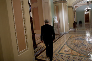 Senate Minority Leader Senator Mitch McConnell (R-KY) walks back to his office after a press conference on Capitol Hill Feb. 2, 2011 in Washington, DC. The U.S. Senate voted down along party lines an amendment to a FAA authorization bill that Senate Republicans attached to repeal the Healthcare and Education Reconciliation Act of 2010 also known as Obama Care.