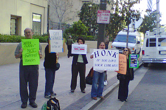 Protesters rally in front of the Central Library in downtown Los Angeles to protest cuts to library services.