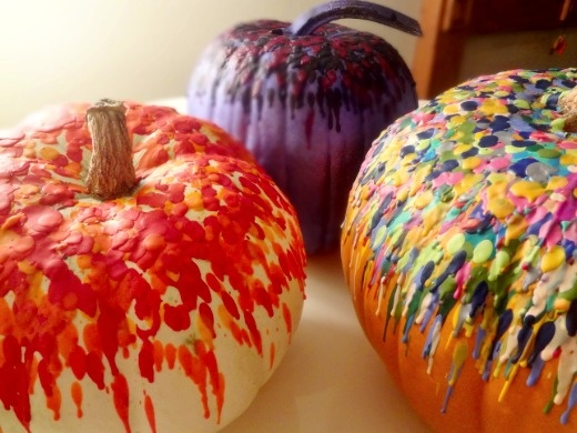 Pumpkins decorated with melted crayons.
