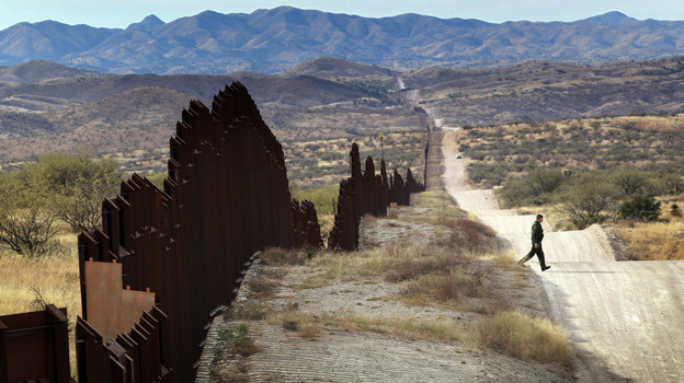 A U.S. Border Patrol agent looks for footprints of people crossing the U.S.- Mexico border in 2010. A border security amendment to the Senate immigration reform bill that would have significantly delayed the path to citizenship for unauthorized immigrants was voted down Thursday.