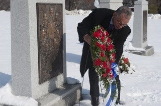 NASA Administrator Charles Bolden places a wreath at the memorial for the Challenger Space Shuttle at Arlington National Cemetery in Virginia on Jan. 27, 2011, to commemorate the agency's National Day of Remembrance.