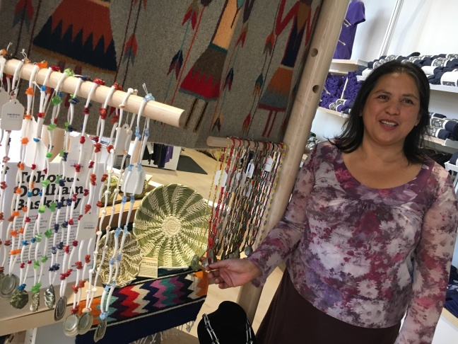 Jilly Canizares, Los Angeles Operations Manager for the Western National Parks Association, Los Angeles, shows off crafts from local Tongva artists at the new Center in downtown L.A.