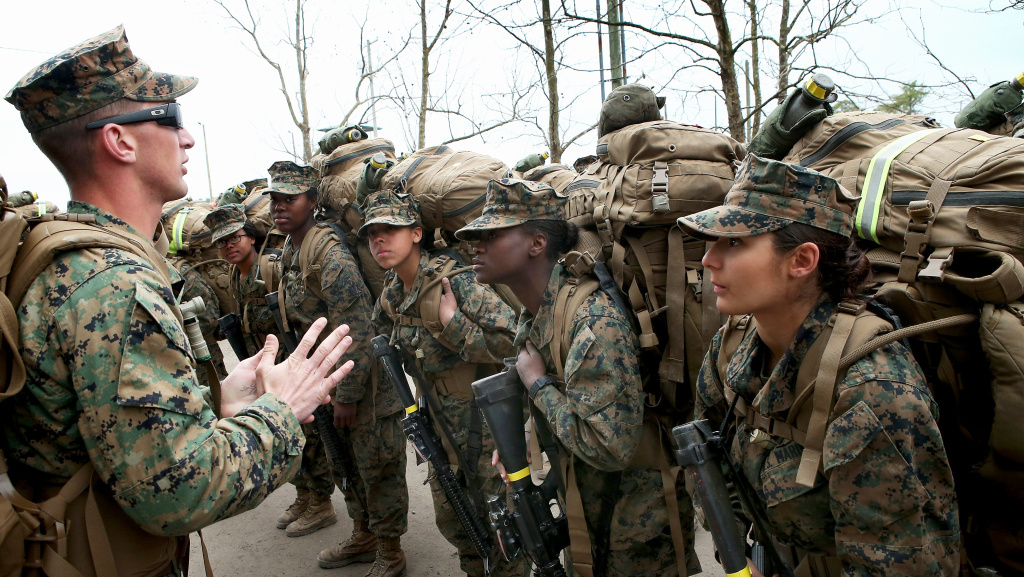 In this file photo, Sgt. Jarrod Simmons speaks to his squad of Marines before they head out on a training march with 55-pound packs on Feb. 22, 2013, at Camp Lejeune, N.C. On Tuesday, the Navy secretary takes his case for incorporating women into combat roles to Camp Pendleton, but he may face a skeptical audience.