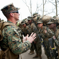 Sgt. Jarrod Simmons speaks to his squad of Marines before they head out on a training march with 55-pound packs on Feb. 22, 2013, at Camp Lejeune, N.C. The Marines and the other military branches must open combat jobs to women in 2016. More than 160 femal