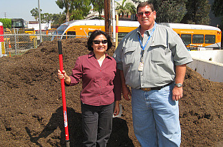 The Bureau of Sanitation's Rosalia Rojo and Jim Kurz, in front of the public Zoo Doo pile.  Dig in!