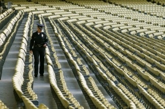 A police officers walks in the seats before the game between the San Francisco Giants and the Los Angeles Dodgers on May 18, 2011 at Dodger Stadium in Los Angeles, California.