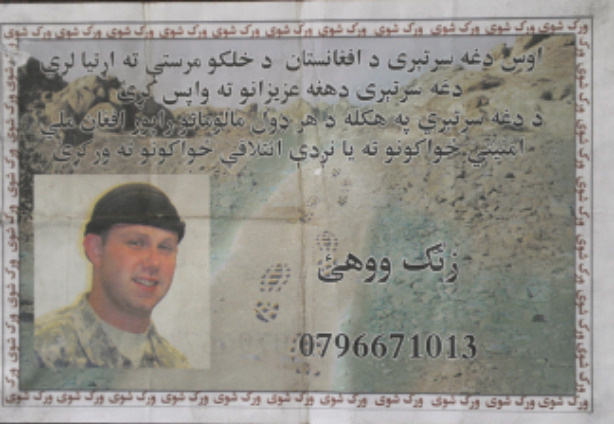 A pamphlet, appealing for information on one of two US soldiers who went missing from their base, is seen in Kabul on July 25, 2010. An extensive ground and air search was underway on July 25 for two American soldiers who went missing in Taliban territory in Afghanistan, military officials said, amid fears one of them had been killed. Nothing had been heard of the two, an official from NATO's International Security Assistance Force (ISAF) told AFP.