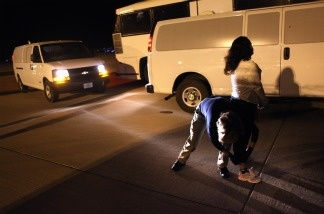 An Immigration and Customs Enforcement (ICE), officer prepares an undocumented Salvadorian immigrant for a deportation flight bound for San Salvador on December 8, 2010 in Mesa, Arizona. Of the 111 Salvadorians on the flight, most had criminal records and were sent home in chains.