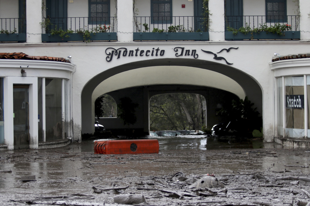 The Montecito Inn on Tuesday, Jan. 9, 2018, as debris and mud cover the entrance of after heavy rain brought flash flooding and mudslides to the area.