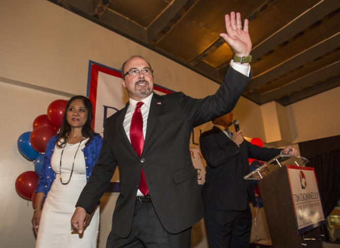 California Republican gubernatorial candidate Tim Donnelly with wife Rowena, waves to supporters after he concedes his run for California governor at his is election night party in Hollywood, section of Los Angeles, Tuesday, June 3, 2014.