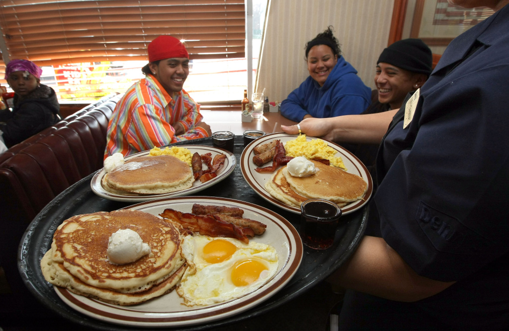 Denny's waitress Tahmina Najemyar delivers free Grand Slam breakfasts to customers February 3, 2009 in Emeryville, California.