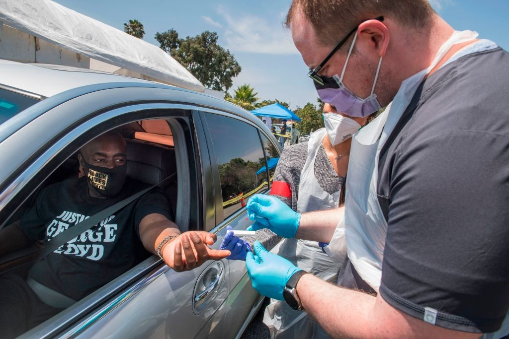 Medical staff from myCovidMD provide free COVID-19 virus antibody testing in observance of Juneteenth at the Faith Central Bible Church, in the predominately African American city of Inglewood, California on June 19, 2020.