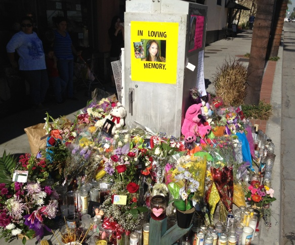 A makeshift memorial on Fourth Street and Broadway for Kim Pham.