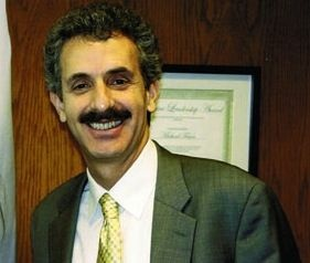 Assemblyman Mike Feuer was hospitalized Monday after his car was struck by a truck that allegedly ran a red light. His campaign consultant says he will remain in the hospital for the next few days.