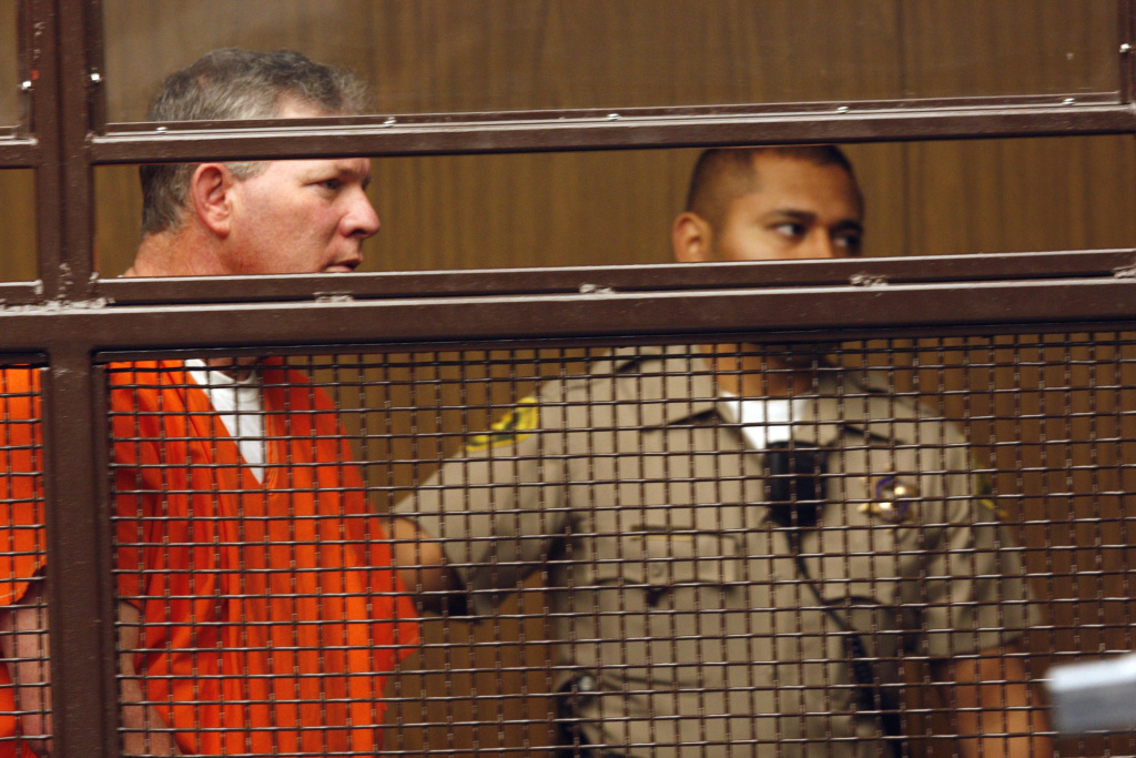 Former baseball player Lenny Dykstra, left, is led into a courtroom in San Fernando, Calif., Thursday, June 16, 2011. (AP Photo/Nick Ut)