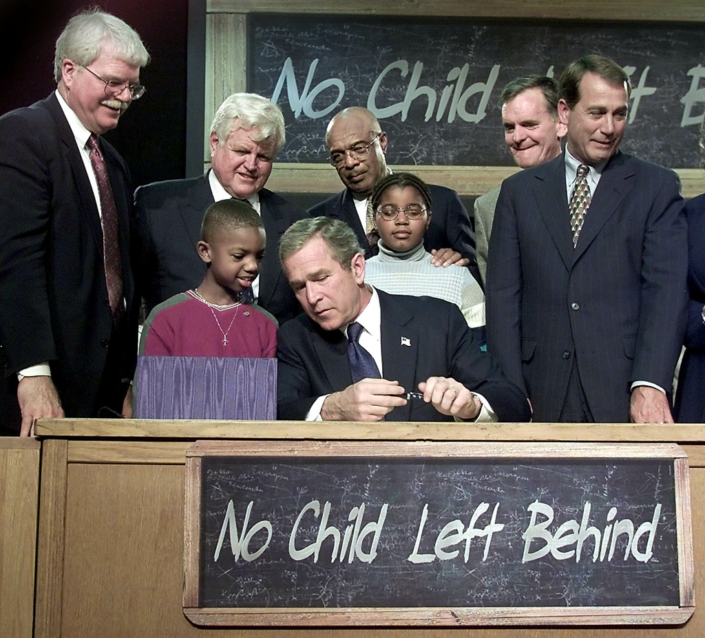 Nine-year-old Tez Taylor talks to former President George W. Bush during the signing of the No Child Left Behind Act at a high school in Ohio on January 8, 2002. On Wednesday, the Senate sent to President Barack Obama a massive education bill that would return to the states significant control over school accountability and testing.