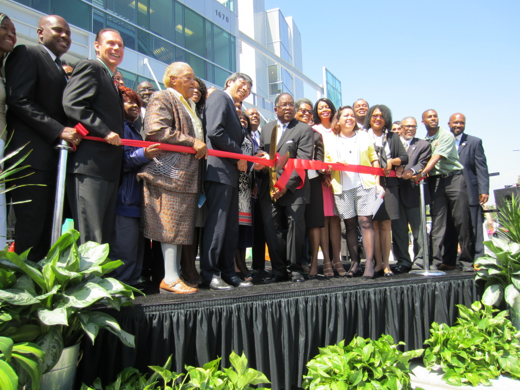 L.A. County Supervisor Mark Ridley-Thomas cuts the ribbon on the new Martin Luther King, Jr. Outpatient Center in south Los Angeles.