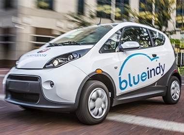 The Bolloré company, which operates the Blue Indy electric vehicle car-sharing program in Indianapolis and another program in Paris, will install 100 electric vehicles and 200 charging stations in Los Angeles.