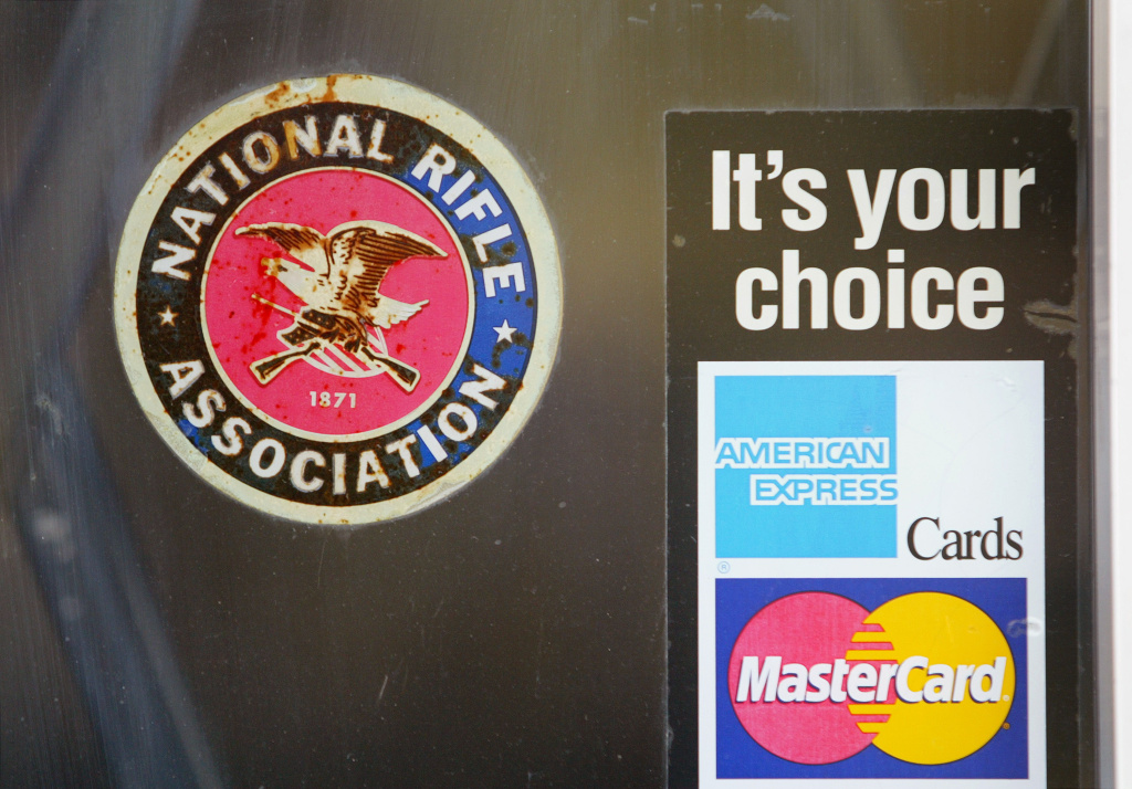 National Rifle Association and credit card stickers are stuck on the front door of the Illinois Gun Works store September 10, 2004 in Elmwood Park, Illinois.