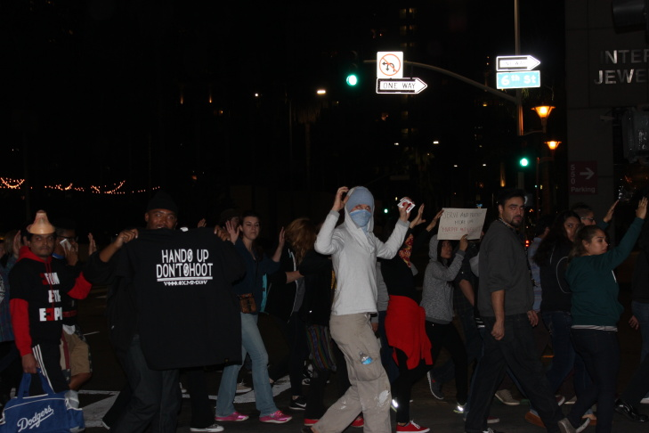 Protesters kneel down with their hands up in front of Los Angeles police officers in downtown Los Angeles on Wednesday, Nov. 26, 2014. People protesting the Ferguson, Mo., grand jury decision took to the streets in cities across the U.S. for a third day Wednesday.