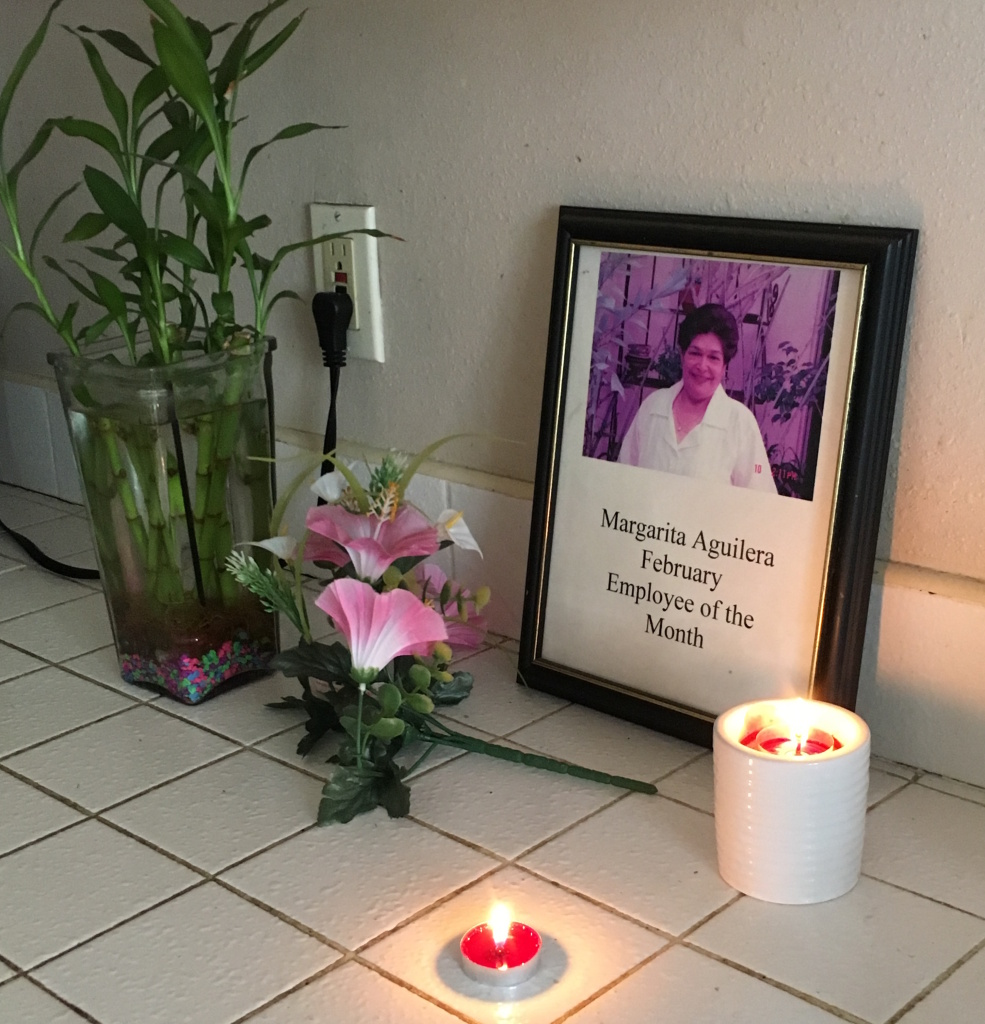 Candles burn in Zoila Margarita Aguilera's kitchen on Oct. 24, 2016. The retired caregiver from El Salvador was among the 13 people who died in the crash of a USA Holiday casino tour bus on Saturday.