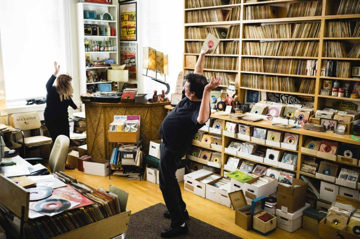 Questlove of The Roots stands surrounded by his record collection. He's just one of the many musicians, DJs, and superfans catalogued in the book,