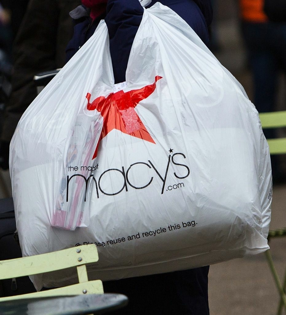 A shopper leaves a Macy's story after a post-Christmas sale.