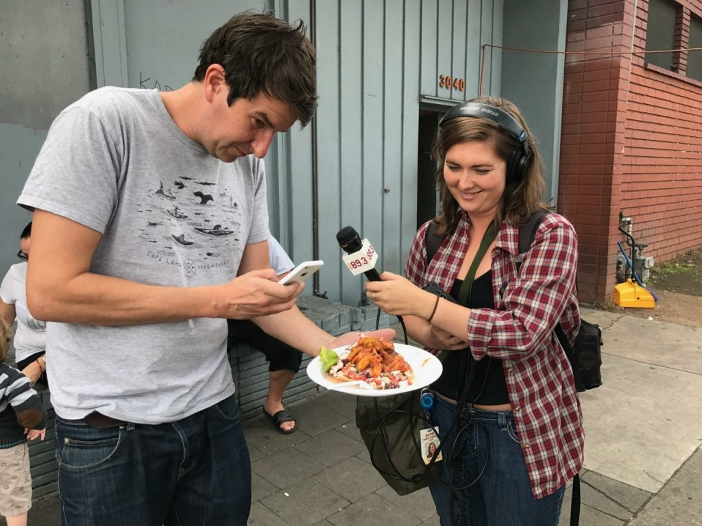 Joe Cobden photographs his Mariscos Jalisco Poseidon tostada during an interview with Off-Ramp intern Rosalie Atkinson