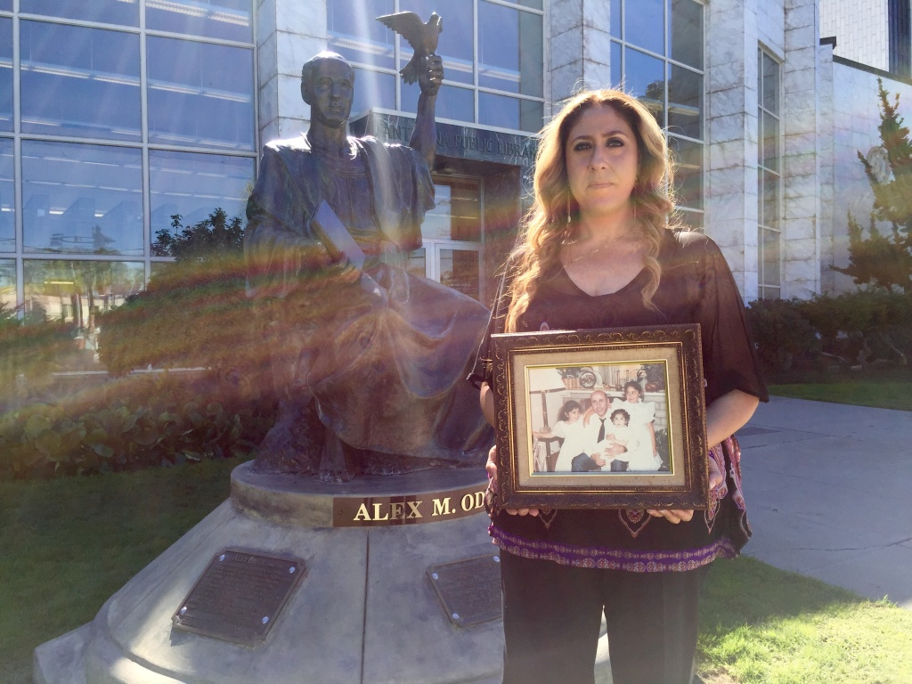 Helena Odeh, 37, the eldest daughter of Arab-American activist Alex Odeh stands near her father's statue at the Santa Ana Public Library. A pipe-bomb planted at the American-Arab Anti-Discrimination Committee office in Santa Ana killed Odeh in 1985 but no arrests or charges have ever been filed.