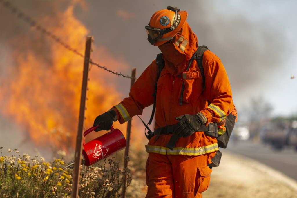 An inmate firefighter from Oak Glen Conservation Camp near Yucaipa, California sets a backfire during the Easy Fire on October 30, 2019 near Simi Valley, California.