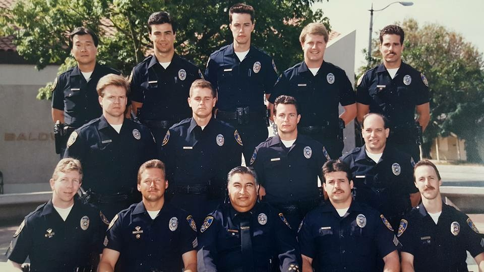 Steve Julian (bottom row, distant left) in 1991, when he was a military officer.