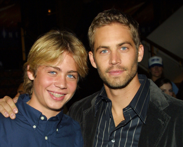 Cody Walker with his brother actor Paul Walker pose during a film premiere at the Mann's National Theatre on November 19, 2003.