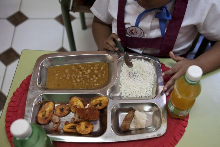 The school lunch of an omelette, vegetable soup, banana yogurt and water are served at the Chiquitin kindergarten in Madrid, Spain, Tuesday, May 6, 2014. Most countries seem to put a premium on feeding school children a healthy meal at lunchtime. U.S. first lady Michelle Obama is on a mission to make American school lunches healthier too. (AP Photo/Daniel Ochoa de Olza)