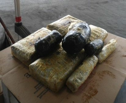 Packages of heroin and methamphetamine found in a non-factory compartment within the undercarriage of a Mazda are shown. In a separate case, a Texas trooper found bundles with more than 6 pounds of heroin in the passenger side rocker panel of a California man's vehicle.