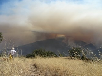 Donna Dormody watches as the Soberanes Fire overtakes her family's ranch in Carmel, California.
