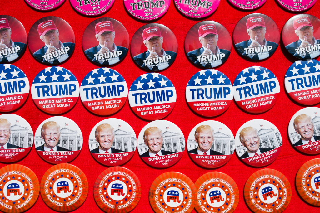 Pins supporting Republican Presidential candidate Donald Trump are seen for sale at a campaign rally on June 1, 2016 in Sacramento, California.