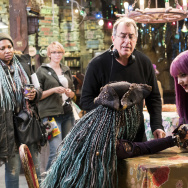 "China Anne McClain (L), director Kenny Ortega, and Dove Cameron (R) on the set of ""Descendants 2."""