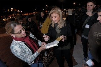 Founder of the Huffington Post Arianna Huffington signs an autograph while waiting to board one of the HuffPost Sanity Buses going from New York City to Washington, DC to attend the 'Rally to Restore Sanity and/or Fear' on Oct. 30, 2010. Huffington reserved 200 buses so rally participants who gathered at CitiField in Queens can get a free ride down to the event.