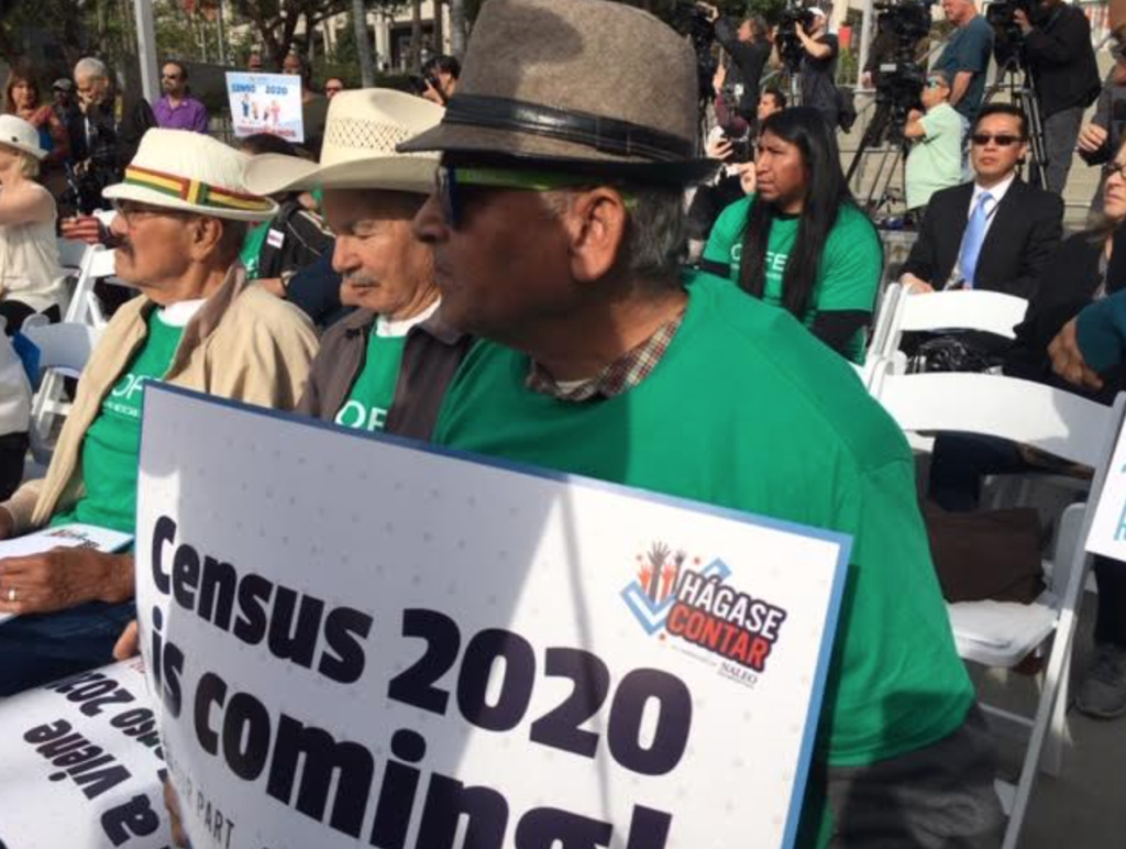A man holds a sign at a downtown Los Angeles rally held by local officials to raise awareness of the importance of participating in Census 2020 on Monday, April 1, 2019.