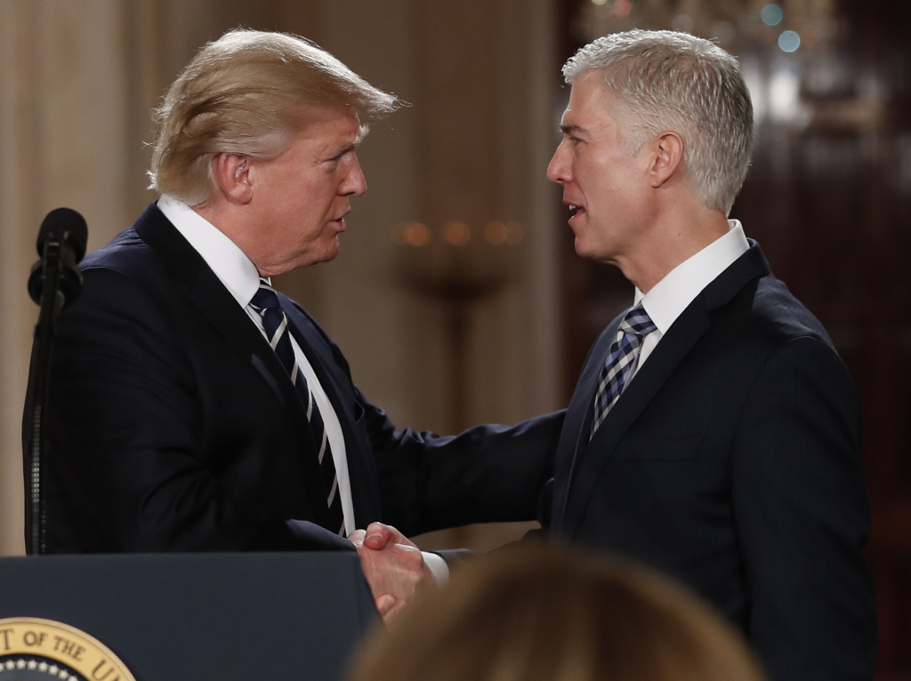 President Donald Trump shakes hands with 10th U.S. Circuit Court of Appeals Judge Neil Gorsuch, his choice for Supreme Court Justices in the East Room of the White House in Washington, Tuesday, Jan. 31, 2017.