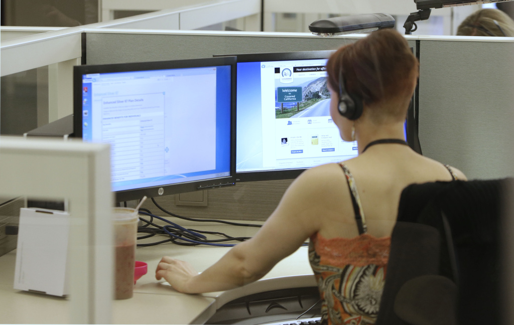 Gina Macaluso, an employee of  Covered California, the state's new health care exchange, provides health insurance at the  newly opened call center in Rancho Cordova.