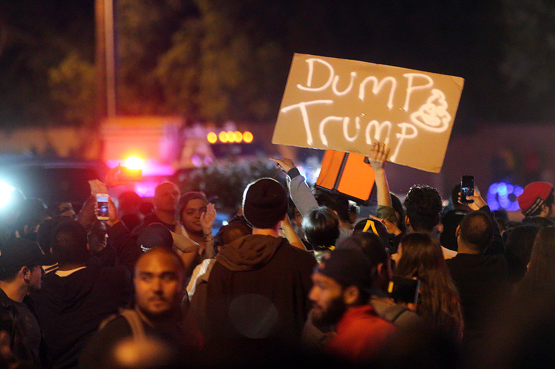 Protesters, Trump supporters and police gather outside a rally for Donald Trump at the Pacific Amphitheater in Costa Mesa on Thursday night, April 28, 2016.