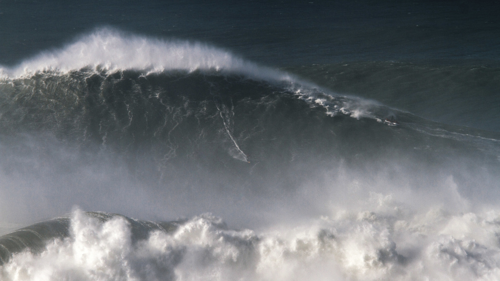Trust us: Brazilian surfer Rodrigo Koxa is <em>somewhere</em> in this shot of his 80-foot ride last November in Nazaré, Portugal.