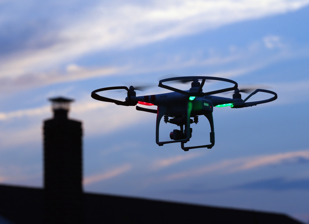 A drone is flown for recreational purposes in the sky above Old Bethpage, New York on August 30, 2015.