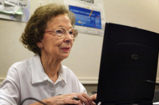 Suzette D'Hooghe, 77, works on her laptop computer during a computer class in Des Plaines, Ill., in 2003. Increasing numbers of people older than 50 are turning to social networking to share updates and connect with family and friends.