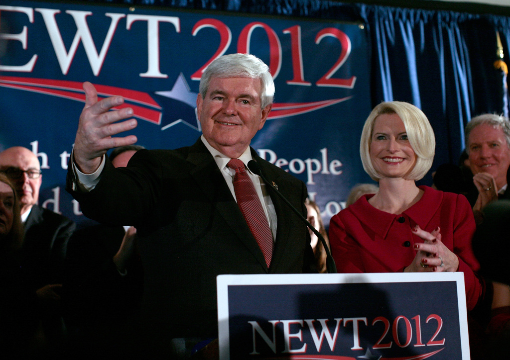 Republican presidential candidate, former Speaker of the House Newt Gingrich (L) speaks during a primary night rally with his wife Callista Gingrich January 21, 2012 in Columbia, South Carolina.