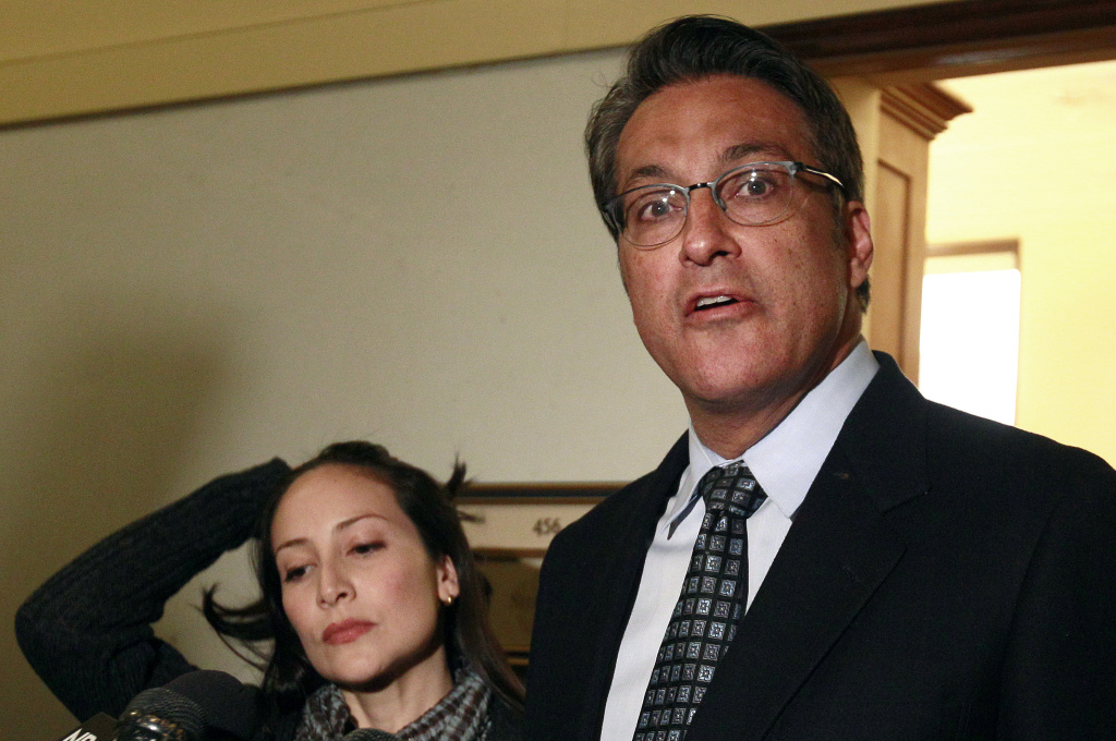 San Francisco Sheriff Ross Mirkarimi, right, and his wife Eliana Lopez speak to reporters at City Hall in San Francisco, Friday, Jan. 13, 2012.