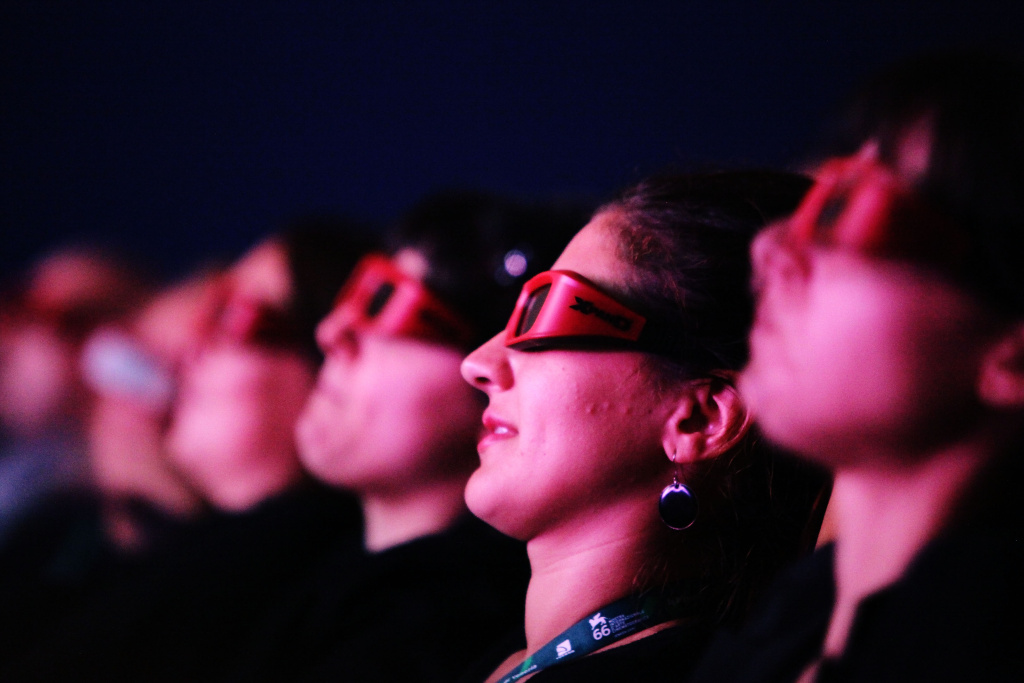 Audience watch through 3D glasses attends the