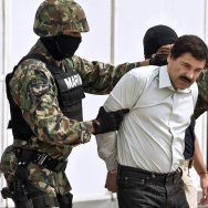 """Mexican drug trafficker Joaquin Guzman Loera aka """"el Chapo Guzman"""" (C), is escorted by marines as he is presented to the press on February 22, 2014 in Mexico City. The Sinaloa cartel leader - the most wanted by US and Mexican anti-drug agencies - was arrested early this morning by Mexican marines at a resort in Mazatlan, northern Mexico. AFP PHOTO/RONALDO SCHEMIDT        (Photo credit should read RONALDO SCHEMIDT/AFP/Getty Images)"""