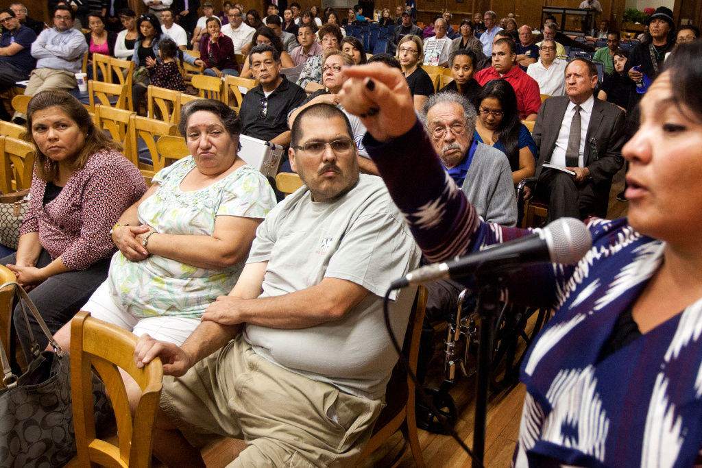 Community members at a town hall about the Exide plant in October 2013. Local anti-Exide activists have been ambivalent about the program to test people's blood for lead contamination, since there would be no way to connect Exide to any positive results.